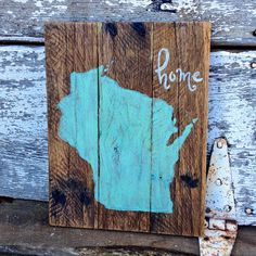 Home sign with Wisconsin state outline hand painted in Mint Green. The word Home is hand painted in creamy white. This sign is constructed of