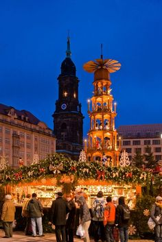 Dresden Christmas Market (Germany's oldest) - TOP 10 Christmas Markets in Germany - It's beginning to look a lot like Christmas! The enchanting smells of roasted almonds and chestnuts, mulled wine and rum punch fill the air. Hot chocolate, potato pancakes and candied apples. Wooden Christmas ornaments and crystal angels. It's all there. Everything's decorated for Christmas with greens and lights and invites you to enjoy traditional Christmas in all shapes, sizes and tastes.