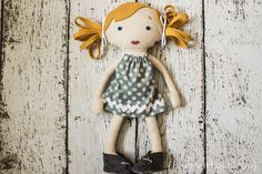 Hey, I found this really awesome Etsy listing at http://www.etsy.com/listing/126623873/handmade-fabric-doll-in-gray-and-cream