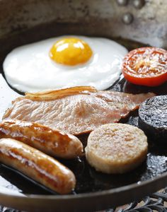 St. Patrick's Day Breakfast Anyone? - A traditional Irish breakfast of bangers, rashers, black pudding, white pudding, tomato, and an egg.  You can find most of these foods at British and Irish import stores.