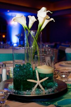 For a Beach theme wedding you don't have to be on the beach. Bring the beach to you by using aqua or seafoam colors with gold or silver or white accents if your budget doesn't allow you to have a destination wedding. www.knotbythesea.com