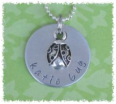 Personalized Hand Stamped Ladybug Charm Silver Aluminum Disc Necklace. $16.00, via Etsy.