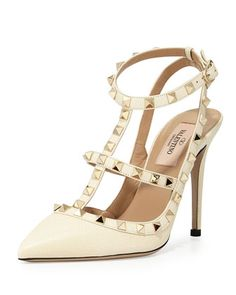 Rockstud Leather 100mm Pump, Ivory by Valentino at Bergdorf Goodman.