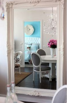 Decor tip: a big mirror opens up a small space {love love mirrors!}