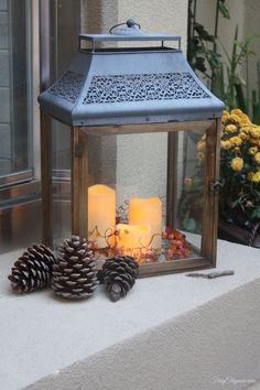 Fall Porch & Courtyard Home Decor. Adding some Fall decor to your outdoor space can be warm & beautiful. Like adding faux flowers to the lantern. And 3 pinecones in front. Outdoor Retreat, Outdoor Decor, Outdoor Ideas, Backyard Ideas, Outdoor Spaces, Garden Ideas, Home Porch, Fall Decor, Holiday Decor