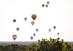 The sky over the Midland County Fairgrounds fills with colorful hot air balloons as pilots take off.