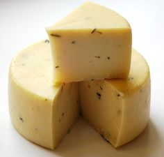 (Pre and Post) Pecorino Tartufo is an old style of Umbrian pressed sheep milk cheese. The cheese's buttery nutty flavor is enhanced with the addition of aromatic black truffles giving it a unique signature.