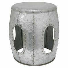"""Showcasing a riveted design and cutout accents, this eye-catching metal stool transitions seamlessly from side table to additional living room seating.   Product: StoolConstruction Material: MetalColor: SilverDimensions: 18.5"""" H x 15.25"""" Diameter"""