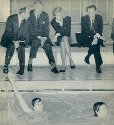 1987-12-07 Diana watches swimmers at Northway School in London which she visits in aid of Special Olympics UK, a training and athletic competition program for handicapped children
