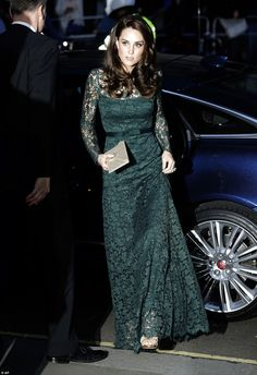 Kate looked momentarily serious as she stepped out of her car in gold Jimmy Choos and a fl...