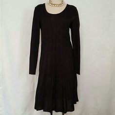 Stylish sweater dress Fashionable sweater dress with detailed ribbing. Scoop neck long sleeves. Looks great with a pair of boots and   some pearls. connected Dresses Midi