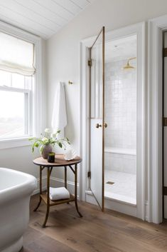 Enclosed shower with pretty hand made tiles. Katie Martinez Design.