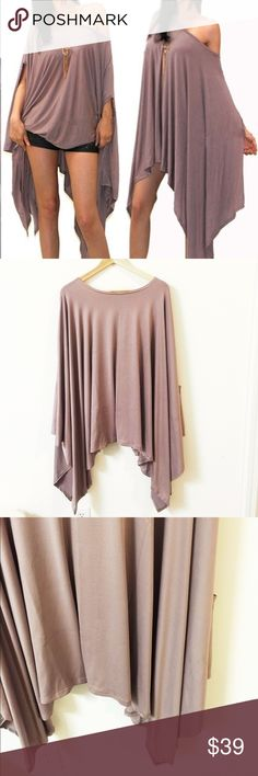 Oversize Poncho Blouse Super chic and cool! Oversized. I normally wear s to M. I tried a S, over sized for me. Nwot. Material: 80% polyester, 10% cotton, 10% rayon. Highly stretchable. True to size Tops Blouses