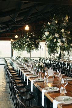 White and green flower chandeliers at winery wedding reception | Sarah Godenzi Photography