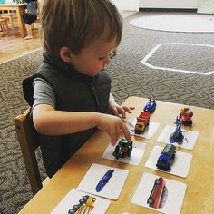Matching objects to pictures is a fun Montessori activity for toddlers. Transportation matching is a big hit in this classroom!