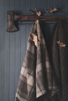 Winter wool blankets hanging with axe by Sandra Cunningham - Stocksy United