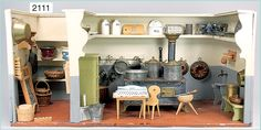 German dollhouse kitchen with pantry, ca. 1880.  Size: 82 cm wide, 39 cm high, 39.5 deep. Permanently installed shelves. Stove with separate bread oven.