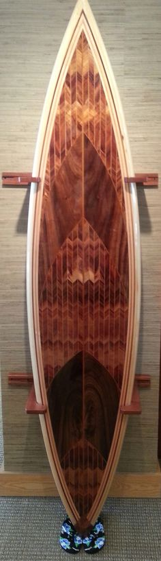 Gorgeous KOA surfboard with herring bone pattern at our Whalers Village store. 808-667-7422.  #surfboards. #hawaii. #koa.  #surf