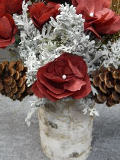 Christmas flower bouquet. made with paper flowers and preserved greens