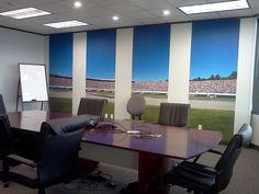 Feel like you are in the middle of the action! Customer Example | Conference Room Decor.