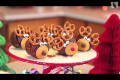 Christmas dessert: Cupcakes with frosting, pretzel ears, vanilla wafer snout, candy eyes, candy noses!