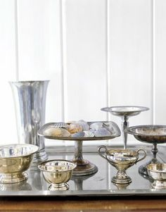 I love groupings of silver candlesticks, but groupings of random silver bowls, urns and objects also make for a chic, timeless look...and polishing the silver is therapeutic!