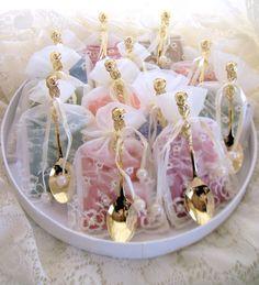 12 Elegant Bridal Shower Wedding Favors Tea and Gold Demi Tea Spoon in White or Ivory Beaded Bag. $59.88, via Etsy.