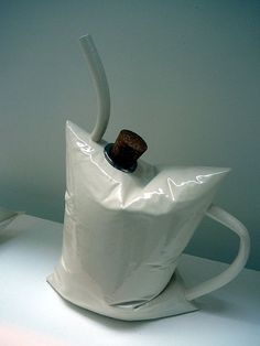 Teapot by Michael Gill.  HILARIOUS - IT LOOKS LIKE AN INFLATED BLADDER OF A WINE CASK, TO ME + THIS IS ART!!!!