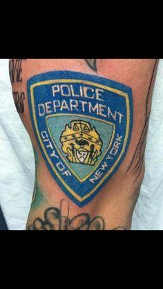 N.Y.P.D shield tattoo - Nephtali Brugueras jr.