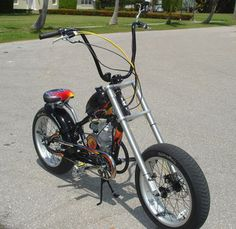 Everything you need to build your own motorized bicycle on your OCC Schwinn Stingray frame. This results in an adult sized chopper style gas bike with ape hangers and all the specialized partsfor the coolest bike around. Mini Chopper, Chopper Bike, Ford F50, C90 Honda, Banana Seat Bike, Bicycle Engine, Motorised Bike, Classic Wooden Boats, Bicycle Pedals