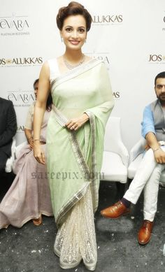 Dia mirza in saree at platinum evara collection launch. The married beauty was in a green and cream transparent half and half saree with sleeveless blouse.