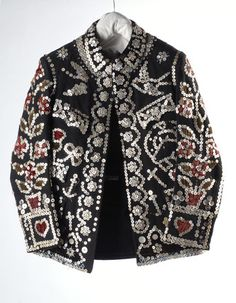 """Pearly Kings and Queens, known as pearlies, are an organised charitable tradition of working class culture in London, England. The practice of wearing clothes decorated with pearl buttons originated in the 19th century. It is first associated with Henry Croft, an orphan street sweeper who collected money for charity."