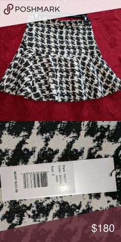Black and White Fit and Flare Skirt Selling a gorgeous fit and flare skirt that I purchased from Bloomingdale's two years ago. Never wore it, NWT. Material isn't very stretchy, runs on the smaller side. In excellent condition. Parker Skirts Mini