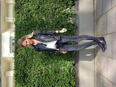 Leather jacket + white T-shirt + faded black skinny jeans + flat leather boots