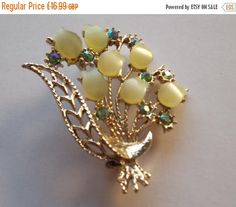 Summer Reductions Vintage 1960s Brooch Pastel Green Rhinestones and Pastel Green Lucite Bouquet by vintageretrojewels on Etsy