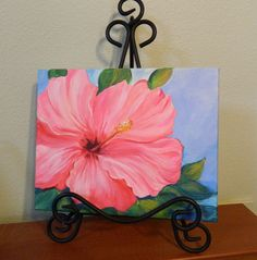 Original Hibiscus Flower Painting, Hibiscus art Pink Hibiscus Flower Original Painting, Gift for her  Original Painting of Lively bright pink hibiscus flower with light blue background and green leaves painted in modern style. Paintings of flowers could be put together or displayed on the wall or shelf. Please see the image with multiple canvases of flowers, paintings sell separately.  Original acrylic painting on canvas over wood frame painted image wraps around edges, could be displayed…