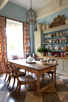 William Yeoward, Gloucestershire country house. Kitchen: The dresser, with the shelves and back panel painted to correspond with the color of the walls. From Vogue (July 2015).