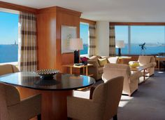 A sunny Liberty Suite showcasing The Ritz-Carlton New York, Battery Park's signature panoramic views.