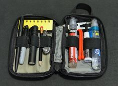 I carry this EDC kit (Maxpedition Micro Pouch) in my camera day pack. * StreamLight MicroStream flashlight, spare AA battery * Gerber Curve Multi-tool * Premium Maxi Deet insect Repellent * Sun Screen spary 30 SPF * Chap-stick * Sharpie, pencil, Space pen * Nite Ize Doohickey * Mini S carabiner * Rite-in-the-Rain notebook * paper clips * Zip ties * Nite Ize Gear Ties * lens cleaner