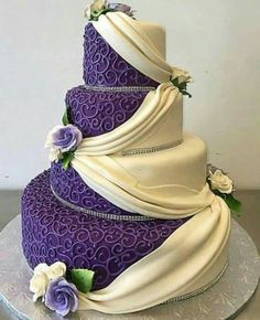 The purple side looks really amazing, but I'd change the white side. Wedding Cakes With Purple, Fancy Wedding Cakes, Beautiful Wedding Cakes, Purple Cakes, Gorgeous Cakes, Wedding Cake Designs, Pretty Cakes, Henna Wedding Cake, Fancy Cakes