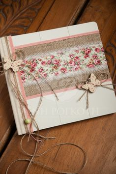An amazing handcrafted wooden guest book embellished with burlap, floral fabric, lace and butterflies.