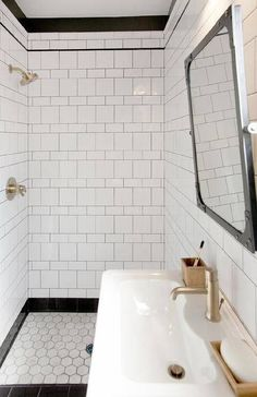 white and black bath with mix of tile shapes, varied layout adding interest, change grout to lighter colour, sink shape good for smaller/narrow rooom