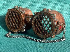 These rustic steampunk goggles were created from Tando Creatives' greyboard kit.  I also used lots of techniques and DecoArt products to create the illusion of rusted patina metal goggles.  You can find the complete pictorial tutorial on Andy Skinner's blog here: http://andyskinnerorg.blogspot.com/2017/06/oh-so-rusty-metallic-steampunk-goggles.html