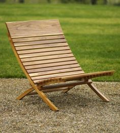 teak chair from Viva Terra, love a low chair for outdoors...