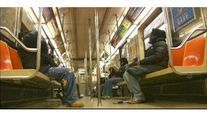 Workers install the floors, AC units, doors and windows in a new R160 New York City subway car.
