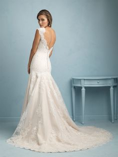 Allure Bridals 9208 | Delicate lace and a slim silhouette make this gown truly timeless.
