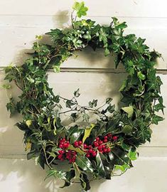Yule wreaths were traditionally made of evergreens and holly and ivy. Holly represents the male and ivy the female and the wreath's circle symbolizes the wheel of the year Christmas Door Wreaths, Holiday Wreaths, Christmas Holidays, Christmas Crafts, Christmas Decorations, Winter Wreaths, Spring Wreaths, Christmas Store, Christmas Vacation