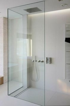 Clean and minimal bathroom designed by Katarzyna Kraszewska. Love the hardware free glass shower enclosure. Minimal Bathroom, Modern Bathroom Design, Bathroom Interior, Bathroom Designs, Bath Design, Bathroom Ideas, Bathroom Renovations, Shower Designs, Modern Bathrooms