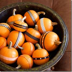 www.goodhousekeeping.com    little pumpkins decorated with bits of ribbon in autumn hues ... just use a dot of glue or double sided sticky tape.