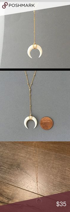 Horn lariat necklace White bone double horn is wrapped in 14k gold fill wire and hangs on a 14k gold fill satellite chain. The pendant measures 3/4ths of an inch in width. The drop of the chain and pendant is 2.5 inches. Jewelry Necklaces
